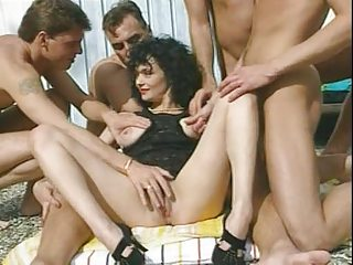 veronique - ebony haired woman with 4 boys by